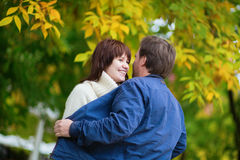 Romantic dating couple on a bright fall day Royalty Free Stock Images