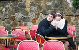Dating couple in a Parisian outdoor cafe Royalty Free Stock Image