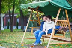 Romantic dating couple on the swing Royalty Free Stock Image