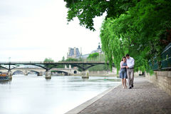 Romantic dating couple walking by the water Stock Images