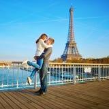 Romantic dating loving couple in Paris. Romantic dating loving couple spending time together in Paris near the Eiffel tower Stock Photos