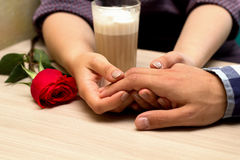 Romantic dating. Male and female hands caressing with love. Couple on dating at coffee shop stock photos