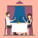 Romantic dating in restaurant. Happy couple sitting at the table with wine glasses Stock Image