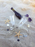 Romantic day with glasses of red wine sitting on the beach Royalty Free Stock Images