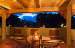 Romantic Deck on Tropical Home at Sunset Royalty Free Stock Photo