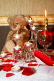 Romantic decoration table set with candles, gasses, roses and Teddy bear. Romantic decoration brown, red and white colors - table set with candles, gasses, roses Royalty Free Stock Photos
