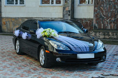 Romantic Decoration Flower on Wedding Car in Black Royalty Free Stock Photography