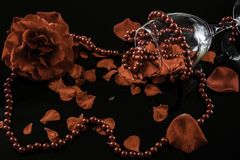 Romantic decoration with rose petals and pearl necklace stock photos