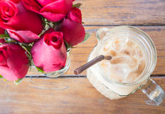 Romantic decoration table with iced coffee latte and red rose Stock Images