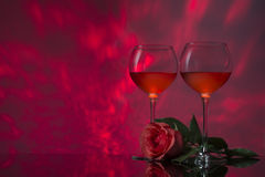 Romantic design with glasses of wine and rose. Stock Image
