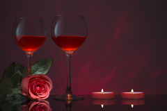 Romantic design with glasses of wine, rose and candles. Royalty Free Stock Photography