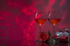 Romantic design with glasses of wine, rose and gift. Stock Image