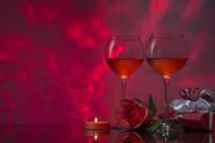 Romantic design with glasses of wine, rose, gift  and candle. Royalty Free Stock Image