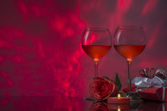 Romantic design with glasses of wine, rose, gift  and candle. Royalty Free Stock Photos