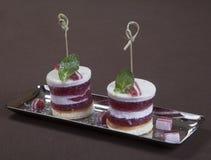 Romantic dessert.  Dessert plate on restaurant table ready. Chocolate ice cream, fruit and biscuits. Romantic restaurant. Stock Image