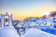 Romantic Destination. Amazing and Breathtaking View of Picturesque Cityscape of Oia Village on Santorini Island with Caldera. Mountains On Background Before royalty free stock image