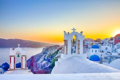 Romantic Destination. Amazing View of Picturesque Cityscape of Oia Village on Santorini Island with Caldera Mountains On. Background Before Dusk. Horizontal stock image