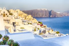 Romantic Destination. Tranquil Picturesque Cityscape of Oia Village on Santorini Island with Volcanic Caldera On Background Before. Sunset.Horizontal Image royalty free stock photos