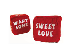 Romantic Dice 2: Want Some Sweet Love 2. A pair of fuzzy red romantic dice for adult play that have landed to say Want Some Sweet Love. One die (Want Some) is Royalty Free Stock Photography