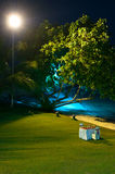 Romantic Diner Setup. A romantic outdoor diner table setup on a lawn by the beach Royalty Free Stock Photography
