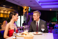 Romantic diner. Young couple on romantic diner royalty free stock photo