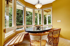Romantic dining corner with round glass wall and wooden furnitur Stock Photos