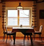 Romantic dining room. Simple lake view dining room taken in winter season Stock Photography