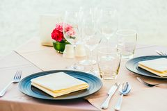 Romantic dining table setting with wine glass and other. With sea and ocean background Stock Photos