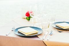 Romantic dining table setting with wine glass and other. With sea and ocean background Royalty Free Stock Image