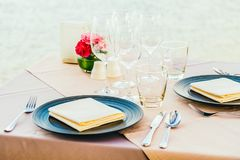 Romantic dining table setting with wine glass and other. With sea and ocean background Royalty Free Stock Photography