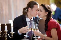 Romantic dinner. Image of amorous couple toasting in restaurant during romantic dinner Stock Photo