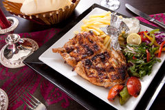 Romantic Dinner. Grilled chicken with chips and vegetables Royalty Free Stock Photo