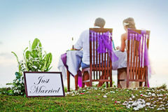Romantic dinner. Back view (soft focus on the just married text Stock Image