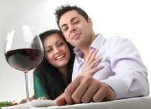 Romantic dinner. Couple having a romantic dinner with red wine, smiling looking at camera Royalty Free Stock Photos
