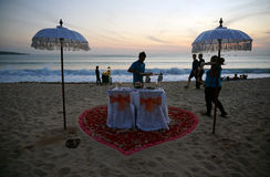 Romantic Dinner Arrangement by the beach at Jimbaran Bali Stock Photo