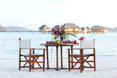 Romantic dinner at the beach. Table setting ready for a romantic dinner at the beach Stock Photos