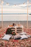 Romantic dinner  at the beach concept stock image