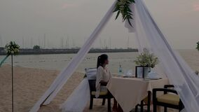 Romantic dinner on the beach, honemoon dinner on the beach during sunset Thailand, valentine setting