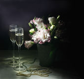 Romantic dinner with bouquet of flowers, candles and champagne glasses. Stock Photo
