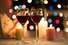 Romantic dinner. With candles and wine royalty free stock photography