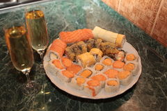 A romantic dinner , champagne glasses and sushi Stock Photos