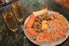 A romantic dinner , champagne glasses and sushi Stock Images