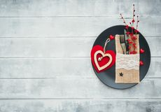 Romantic dinner concept. Festive table setting for Valentines Day. On wooden background Stock Photography