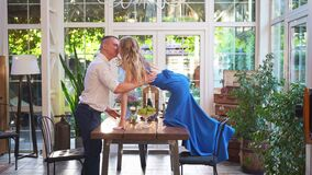 Romantic dinner for couple. girl with glass stands on table to kiss boyfriend.