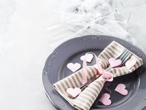 Romantic dinner date plates hearts champagne glasses on gray Stock Photos