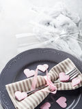 Romantic dinner date plates hearts champagne glasses on gray Stock Image
