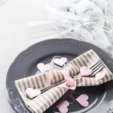 Romantic dinner date plates hearts champagne glasses on gray Stock Photography