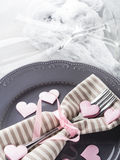 Romantic dinner date plates hearts champagne glasses on gray Royalty Free Stock Image