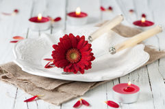 Romantic dinner. With gerberas and candles, selective focus Stock Photo
