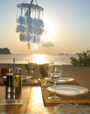 Romantic dinner on the ocean. A romantic dinner set up near the ocean Royalty Free Stock Photo